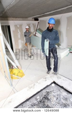 Workers in a house under construction