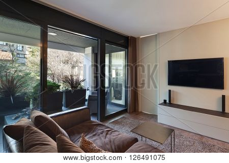 Interiors of new apartment , living room with divan and television