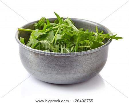 Fresh green arugula in bowl isolated on white background
