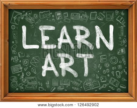 Learn Art Handwritten on Green Chalkboard with Doodle Icons Around.