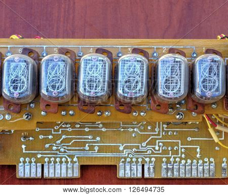 Electronic board with old style indicator lamps closeup