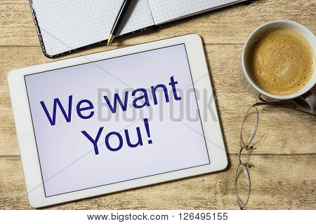 tablet with we wantr You on table with coffee