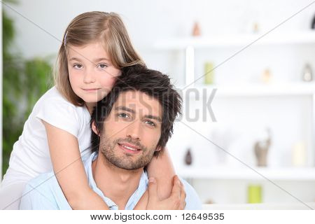 Portrait of a man and a girl smiling
