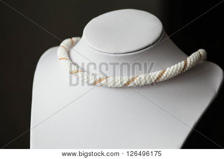 Beaded Necklace From Beads Of White And Golden Color