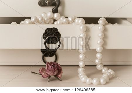 White pearls necklace in a wooden casket