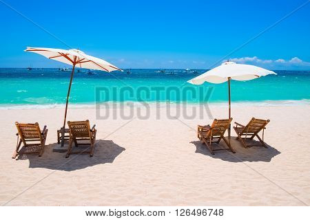 White sand beach with umbrellas and chairs, Boracay island, Philippines