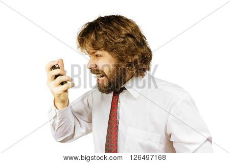 Evil shaggy bearded man shouts into the phone. Isolated on white background