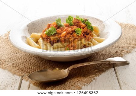 penne rigate with tomato sauce minced meat and parsley