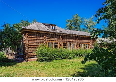 Russian big log house in summer day. Countryside