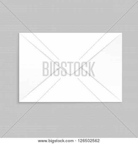 White envelope for identy design. Blank envelope isolated on light gray background with clipping path