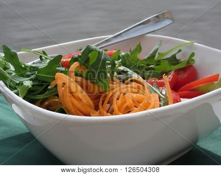 Fresh spring salad with tomatoes rucola and carrots
