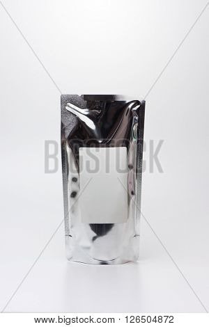 Aluminum sealed pack with blank label, isolated on natural white background. Often used for refill of health care supplies.