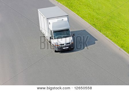 Blank white truck isolated on road