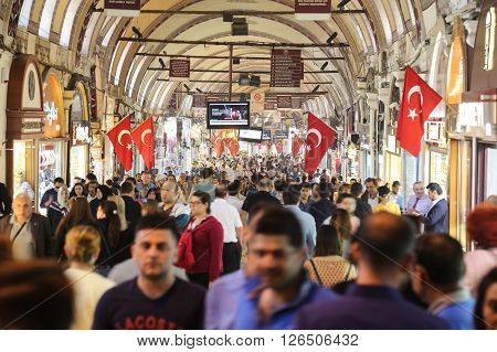 ISTANBUL TURKEY - APRIL 09 2016: People shopping in the Grand Bazaar. The Grand Bazaar is one of the largest and oldest covered markets in the world.