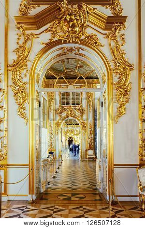 SAINT PETERSBURG, RUSSIA - MARCH 17, 2016: Enfilade of the rooms of the Catherine Palace in Tsarskoye Selo (Pushkin). It was summer residence of the Russian tsars, now it is a famous museum