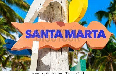 Santa Marta signpost with palm trees