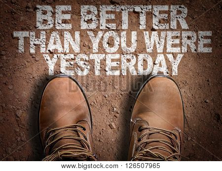 Top View of Boot on the trail with the text: Be Better Than You Were Yesterday