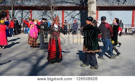 BEIJING CHINA - JANUARY 12 2016: local people in traditional costume during a choreography rehearsal in a public square