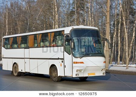tourist blank white shuttle bus on road