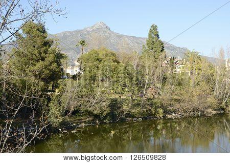 La Concha mountain seen from a lake in Marbella Spain.