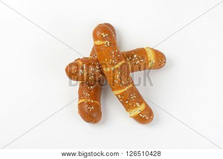 three fresh bread rolls on white background