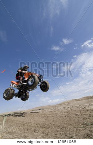 Teen jumping ATV