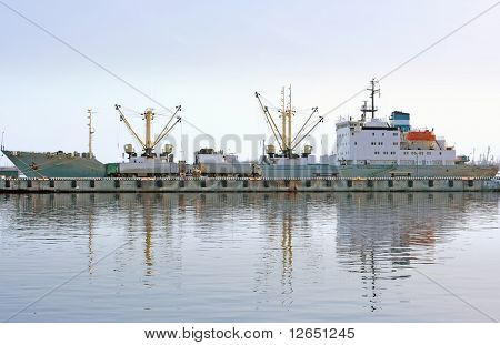 ship on a berth in port loading/unloading 