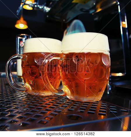 big Beer glass on a bar table. Closeup ** Note: Visible grain at 100%, best at smaller sizes
