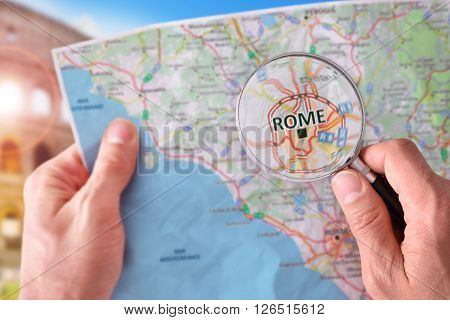Man Consulting A Map Of Rome With A Magnifying Glass