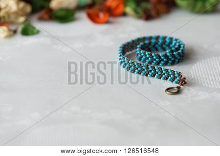Wattled Necklace From Beads Of Turquoise And Brown Color