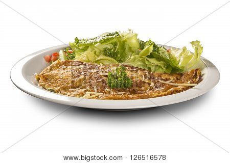 Omelette served with salad on the plate.