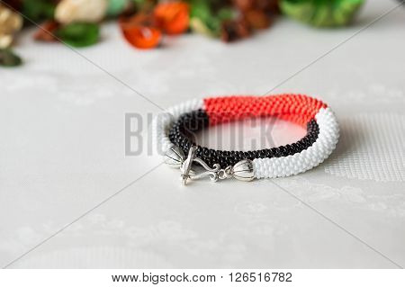 Crochet Beaded Necklace Of Red, White And Black Color