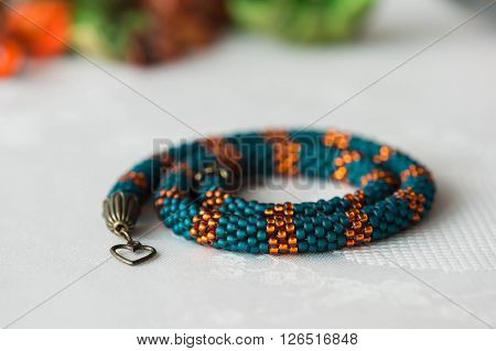 Handmade Necklace From Beads Of Emerald And Orange Color