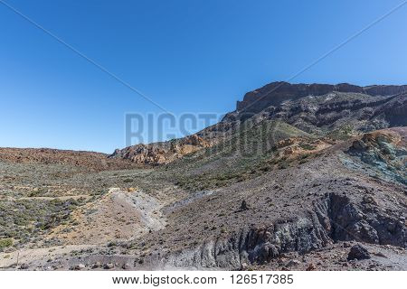 Lava fields stretched from horizon to the top of the volcano Teide on Tenerife.