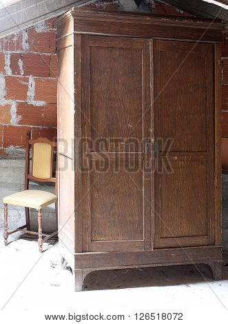 Antique Wooden Wardrobe In The Dusty Attic