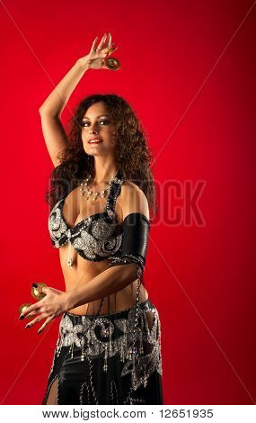Beauty woman belly dance with finger cymbals