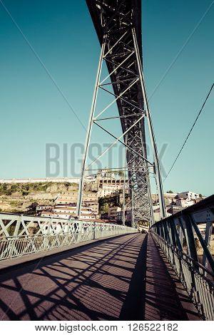 Street on lower floor of the Ponte Luiz I Bridge in Porto Portugal.