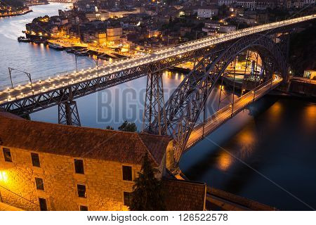 Night view of the historic city of Porto Portugal with the Dom Luiz bridge