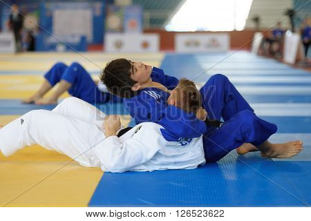 ST. PETERSBURG, RUSSIA - APRIL 16, 2016: Match Eradzh Abdulloev of Tajikistan (blue) vs Michel Adam of Germany during the Junior European Judo Cup. 346 athletes participated in the competition