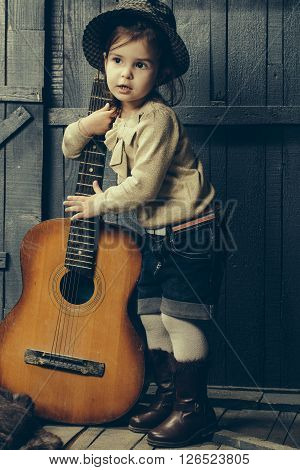 Small Girl With Guitar