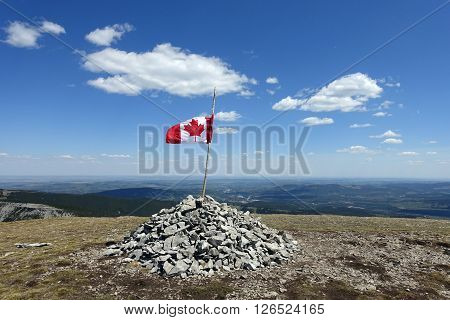 Picture of a Canadian flag on top of Prairie Mountain in Kananaskis,Alberta,Canada.