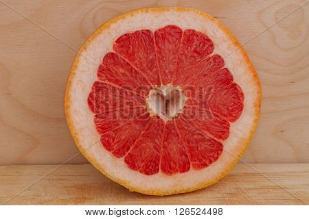 grapefruit in the section on wooden background