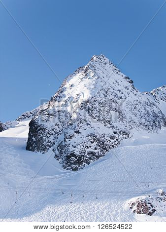 Stubai Alpen glacier peak with pistes in winter