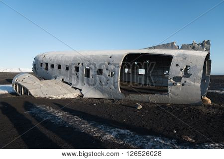 Wrecked airplane on the black beach in Iceland