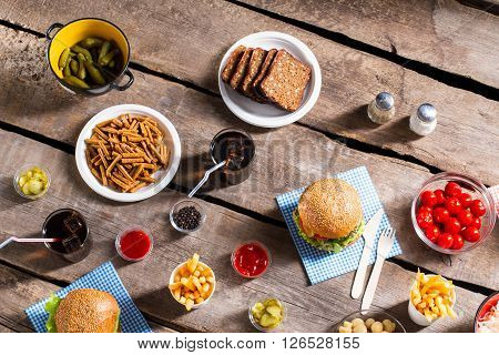 Crackers and bread with burgers. Food and cutlery on table. Spice up your life. Savory meal in local diner.