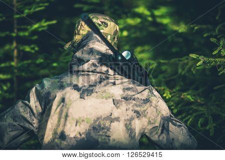 Forest Hunting For Wildlife. Illegal Poaching Activity Photo Concept. Illegal Forest Hunter.
