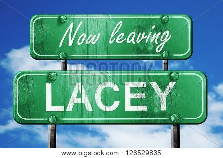Now leaving lacey road sign with blue sky