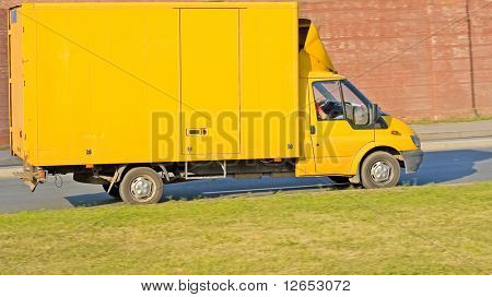 blank yellow big delivery truck on road