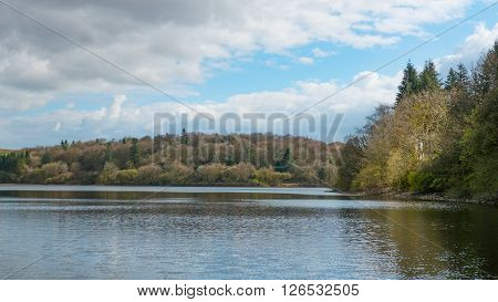 A landscape photograph of a resivior surrounded beautiful countryside located in Cornwall and Devon.