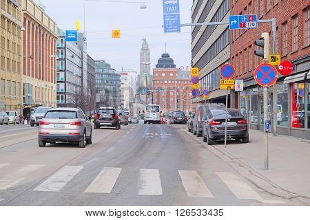 HELSINKI, FINLAND - April, 4, 2016: traffic on a street of Helsinki, Finland.